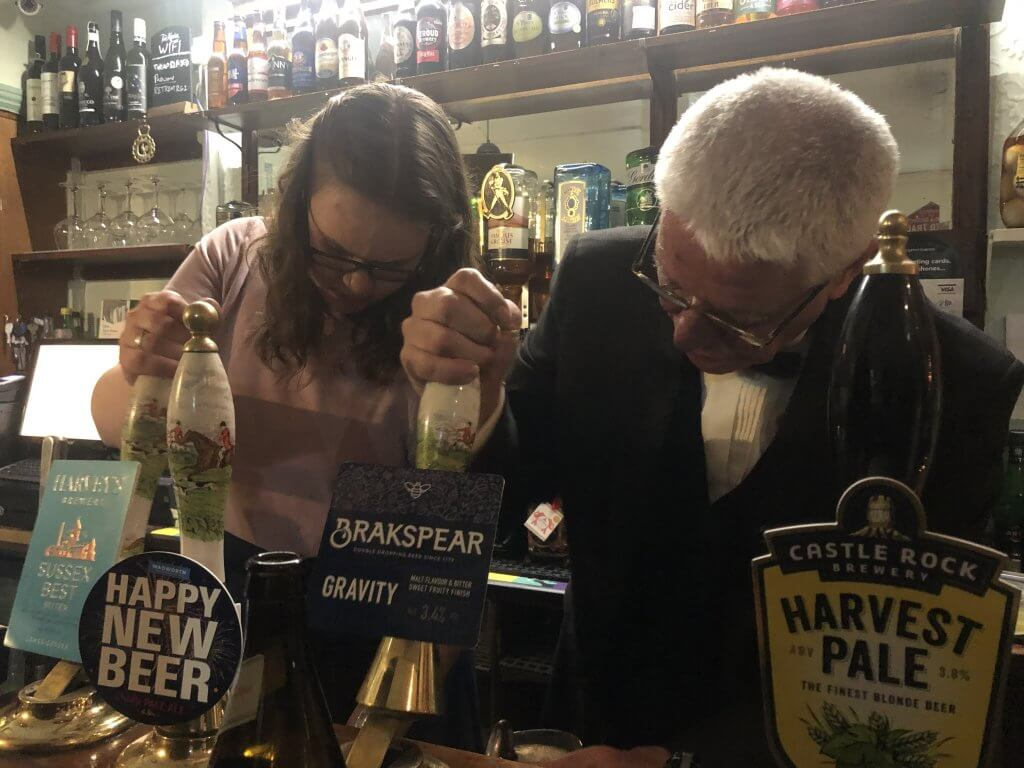 Anita and Brian Moignard pulling pints on New Year's Eve at The Retreat pub in Reading